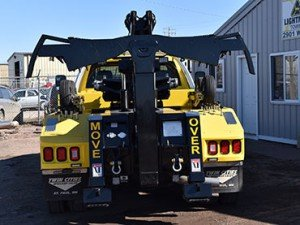 back of tow truck flatbed towing services